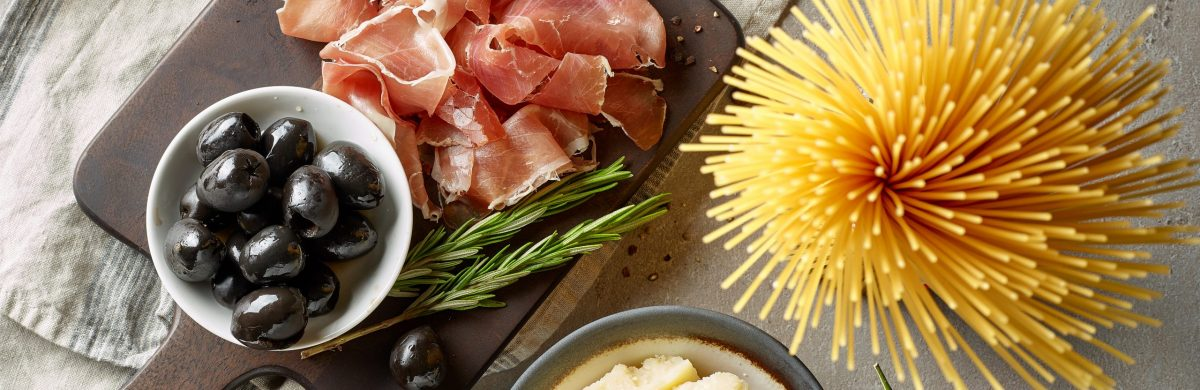 healthy italian food ingredients on grey kitchen table, top view
